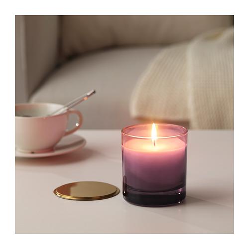 NJUTNING aromatizētā svece stikla traukā