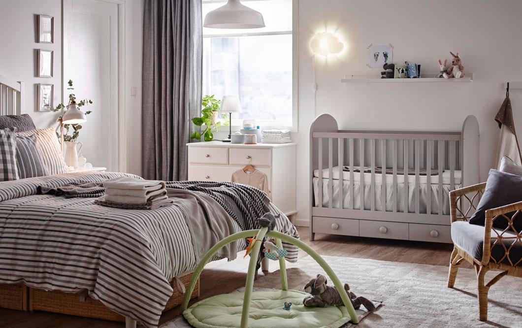 A baby cot in parent\'s bedroom